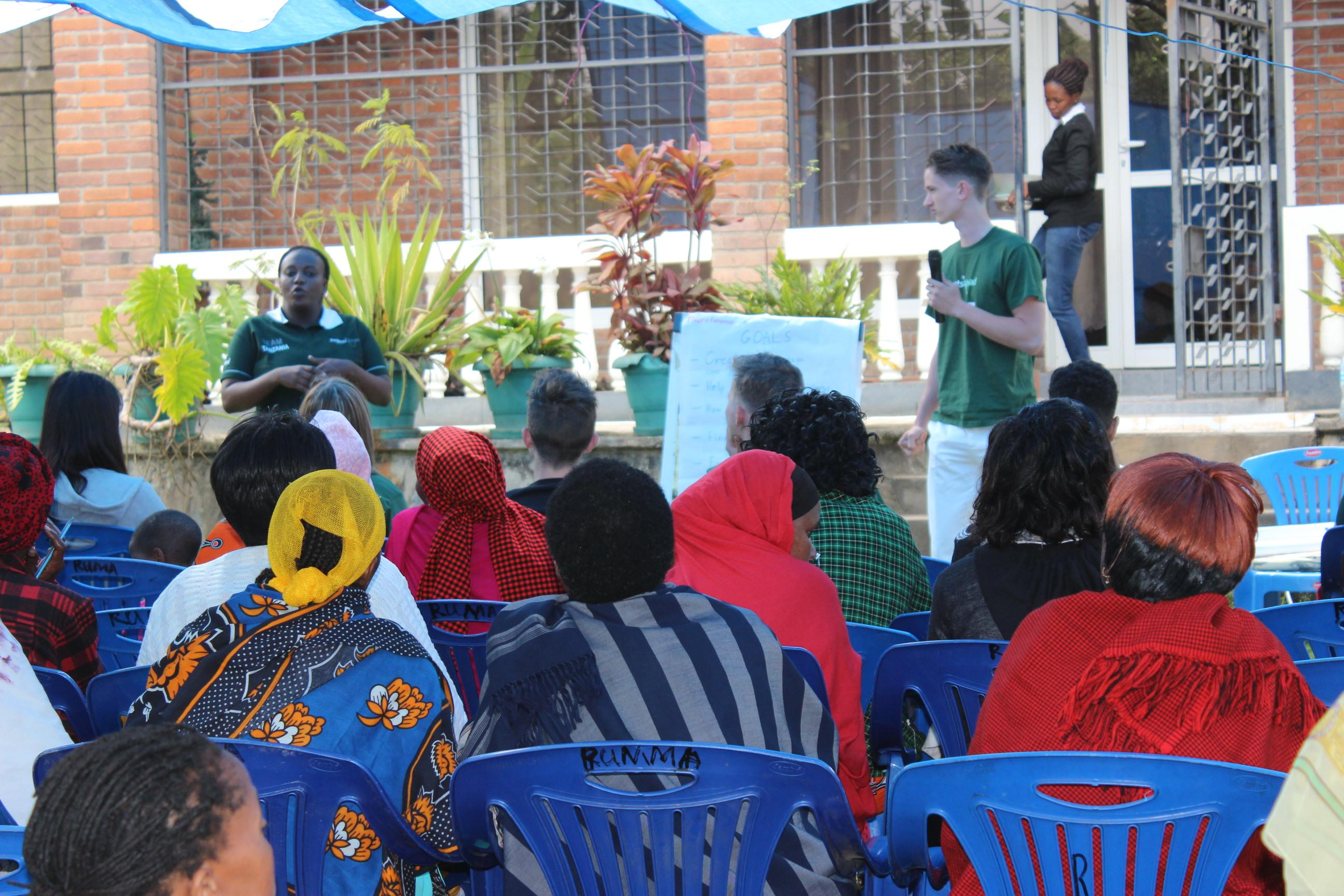 Interns give a presentation to a group of women business owners and gain micro-finance work experience in Tanzania.